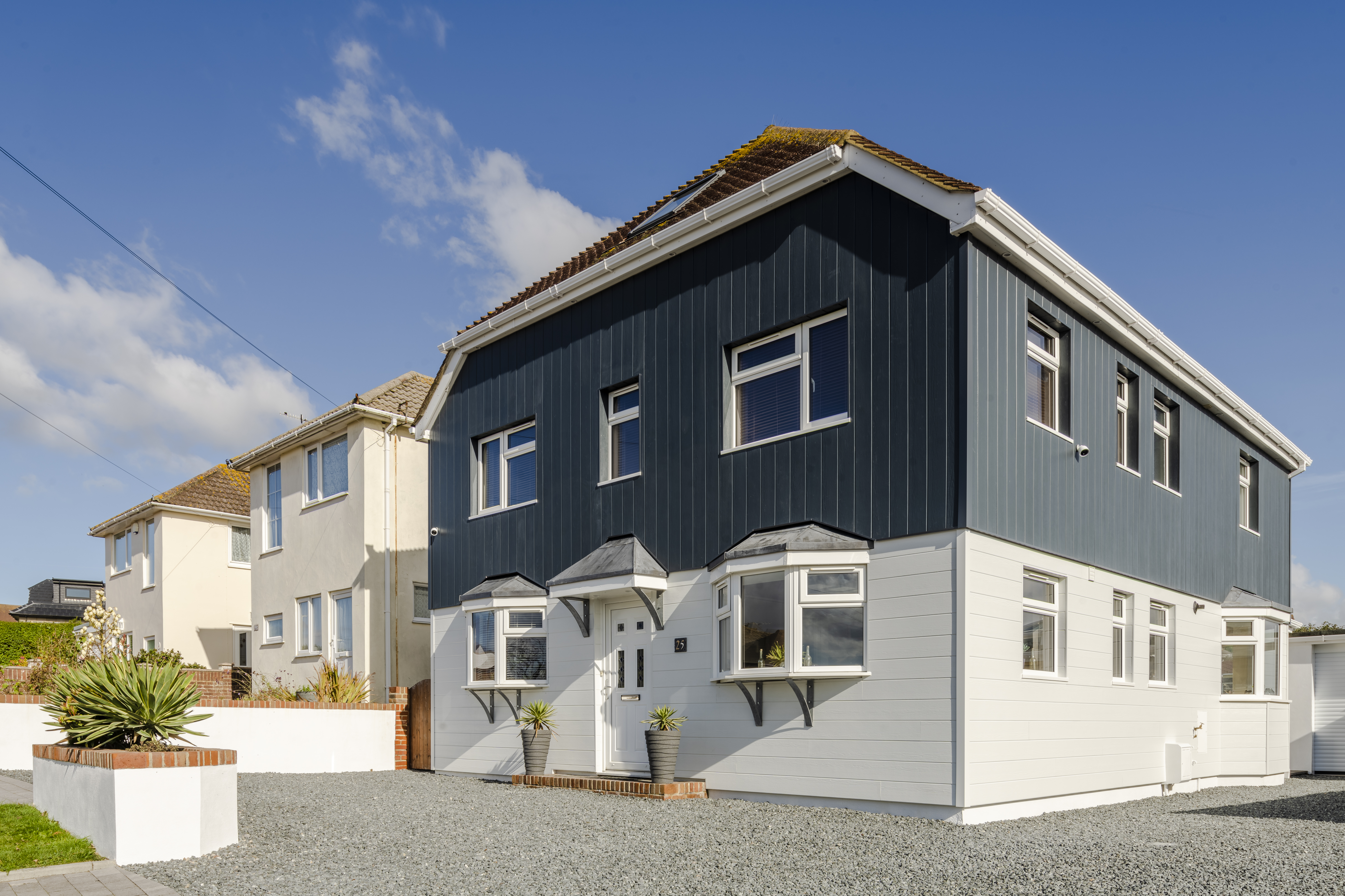 HardiePlank VL tongue and groove weatherboard transforms old render home