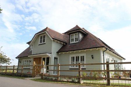 HardiePlank®: Weatherboard in Soft Green upgrades Traditional Sussex styled home